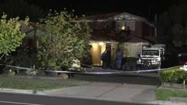 Police forensics officers at a Hoppers Crossing home where a woman's body was found on Thursday night.