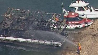 The charred remains of the house boat.