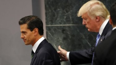 Republican presidential nominee Donald Trump walks with Mexican President Enrique Pena Nieto at the end of their joint statement in Mexico City.