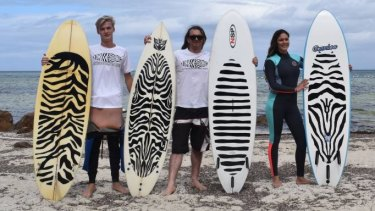 Mark Knight, Matt Cole and Jessica Gosnay with the different surfboard designs which they believe will deter sharks.