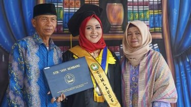 'What's wrong with your daughter?': Sanita Rini with her parents on graduation day. They had pressed her to marry when she was 13.