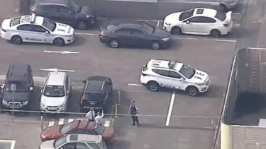 Police at the scene of a shooting at Bankstown Central Shopping Centre.