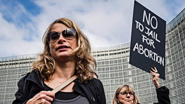Polish women protest against a Polish legislative proposal for a total ban on abortion, near EU headquarters in Brussels, on Monday.