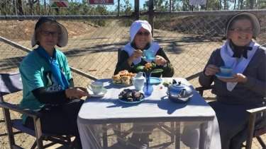 The trio allegedly set up a tea table at the Australian Defence Force's Shoalwater Bay training area on Monday afternoon.
