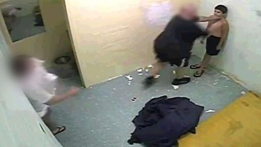 Officers restrain a youth detainee in the Northern Territory in 2010.