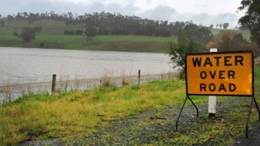 A flooded road and paddock in Yinnar near Morwell.