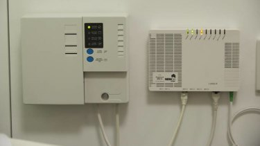 The NBN power supply unit with a back-up battery, left, that is causing headaches.