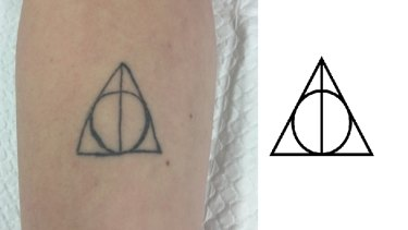 A wonky Harry Potter symbol that was removed, next to a straighter version of the symbol.