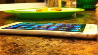 MacRumors user DevinPitcher shows off a bent iPhone.