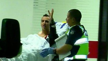 Ahmed Al Hamza pictured in 2016 being wheeled into the Royal Melbourne Hospital after being shot.
