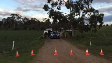 Police at the Hillier property where a woman and two children were found dead on Monday afternoon.