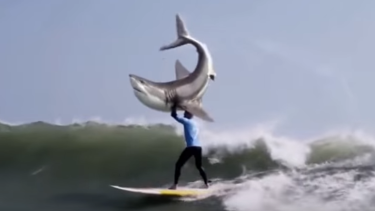 In poor taste? A Mick Fanning lookalike lifts a shark above his head in this ad for a KFC burger.
