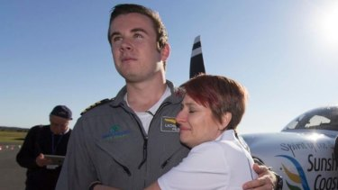 Lachlan Smart with his Mum Vanessa Sprague after becoming the youngest pilot to fly solo around the world.