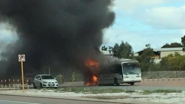 The fire took only a few minutes to destroy the coach, an onlooker said.