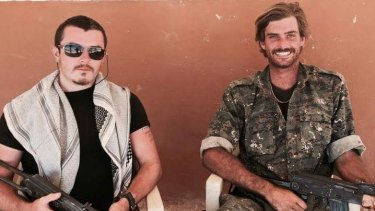 Brisbane man Ashley Dyball, left, pictured here with fellow Australian Reece Harding, right, who was killed fighting IS in Syria.