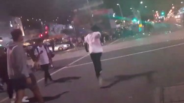 Apex gang members rioting outside Flinders Street station.