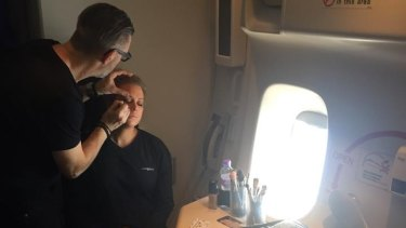 Channel Seven make-up artist Garry Siutz working on Samantha Armytage, on the descent into New York.