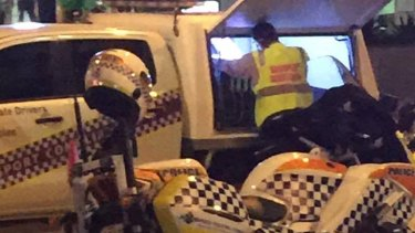 Transport officers booking Uber drivers on Eagle Street.