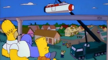 The Simpsons watch on as Springfield's monorail is built.