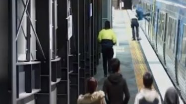PSOs drag 'Stephen' from a train at Springvale station last year.