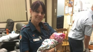 Queensland paramedic Pam with the baby girl.