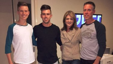Jordy Hurdes with his mum, dad and brother.