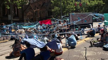 The protesters chained themselves together in Collins Street.