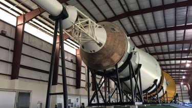 The giant Saturn V rocket which launched us to the Moon, complete with a rusted Command Module, on display at Johnson Space Center in Houston, Texas.