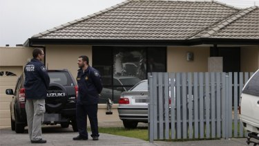 Police outside a house in Hallam during the Melbourne counter-terrorism raids.