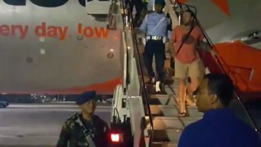 One of the men being escorted from the plane.