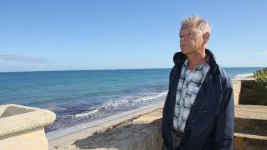 Seabird GP Jim Batalin surveys the sea advancing towards his home's boundary wall.