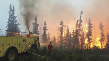 Firefighters tackle a wildfire near the town of La Ronge, Saskatchewan.
