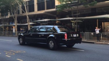 Barack Obama's armoured vehicle, known as The Beast, travels down Adelaide Street in the Brisbane CBD.