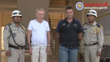 Victorian man Guido James Eglitis (left) and another foreign suspect under arrest in the Cambodian town of Siem Reap last year.