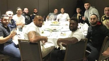 Dinner at The Century: Rafat Alameddine (fifth from left in black shirt) and former bikie Paulie Younan (sixth from left at back of table) pictured with Corey Norman, James Segeyaro and Junior Paulo.