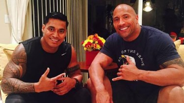 "Family values: Junior Vaivai with cousin Dwayne ""the Rock"" Johnson."