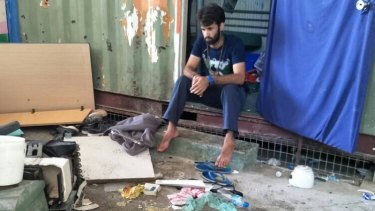 A man inside the decommissioned detention centre, where belongings were reportedly trashed in a police operation on Thursday.