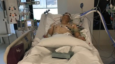 The carjacking victim in his hospital bed.