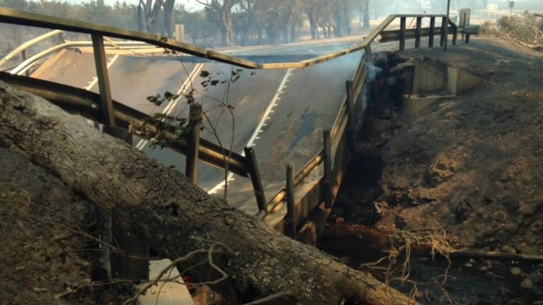 The intense heat of the bushfire has caused the Samson Brook bridge asphalt to buckle and collapse.