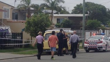 Witnesses at the scene help police with their investigation.