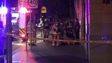 Firefighters on Redfern Street in Redfern on Tuesday night.