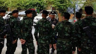 Thai police at the apartment block where the man was arrested.