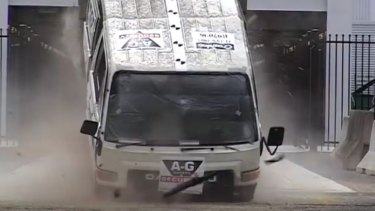 This image shows the moment a speeding truck hits a bollard.