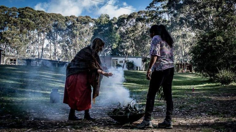 Wendy Lotter (right) at a Women Wisdom Retreat Camp smoking ceremony.