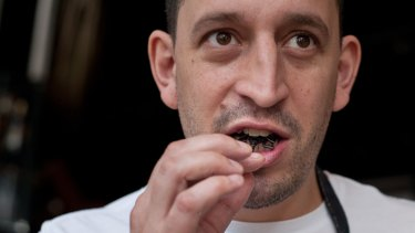 Public Bar and Restaurant head chef Damon Amos tucks into some insects.