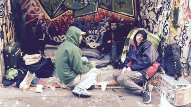 """""""We are homeless, not terrorists"""": Stuart Poden (pictured in blue) says of those who live in Hosier Lane."""