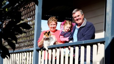 Works for us: Enjoying  family life across generations, Carol and Bruce Muston with their grand-daughter Evie.