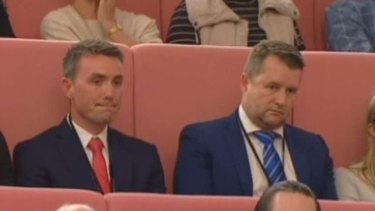 Bill McNee (right) in the federal parliament at Pauline Hanson's maiden speech last year, with One Nation adviser James Ashby (left).