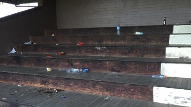 Cans and bottles strewn about the grandstand at Monash Park at Gladesville on Sunday.