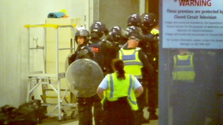 Riot police and dog handlers were called to the Parkville centre last November.